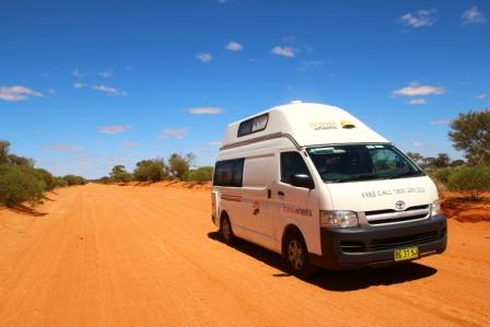 Driving in Australia tips - photo of campervan in the outback of Australia