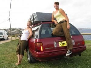Two girls standing by a used car for sale in Sydney