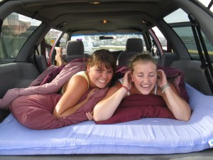 Two girls in the bed in the back of Travelwheels Cheap Car hire Sydney special