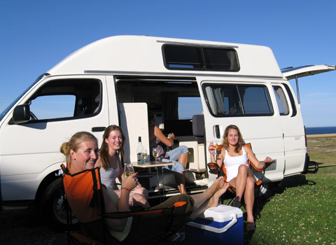Four lovely dutch girls enjoying some wine outside their used campervan