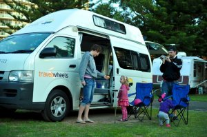 Family friendly autoamtic campervans - photo of a family playing outside by the camper