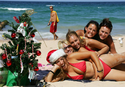 5 lovely girls in bikinis on the beach after getting a Travelwheels Christmast campervan hire sydney special
