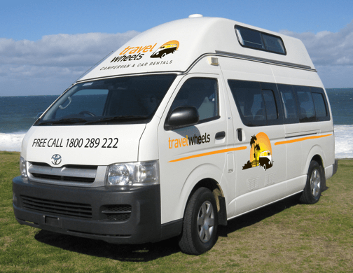 5 person automatic Campervan for Hire in Australia - side view of camper at the beach