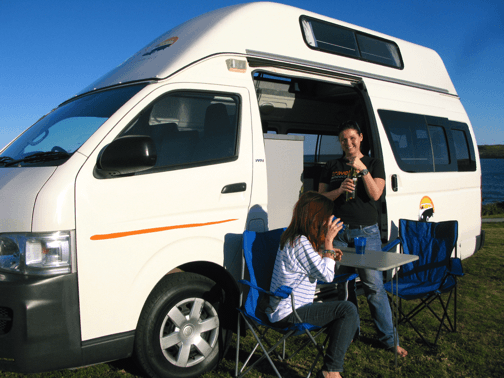 Two lovely girls enjoying the sunshine outside of the campervan