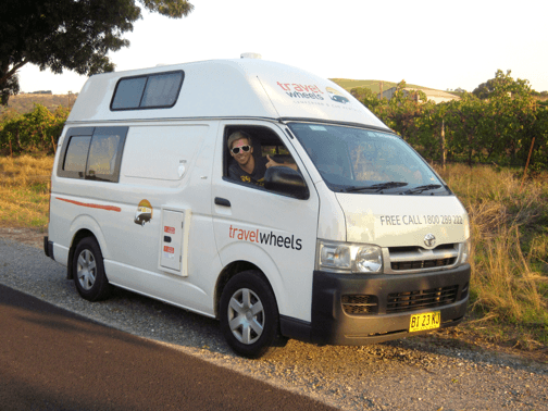 Photo of campervan by side of the road in Australia with happy people!