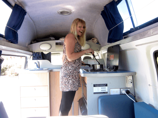Lovely Sara cooking in the back of Travelwheels Campervan Hire Australia van