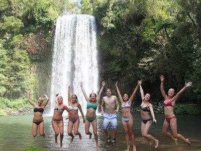 Group of girls playing in the waterfalls by Atherton