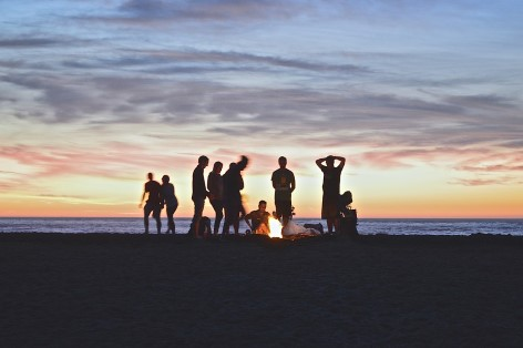 Meeting new friends by campfire at the beach