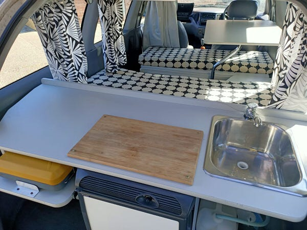 Inside the Toyota 2 person campervan for sale lounge area