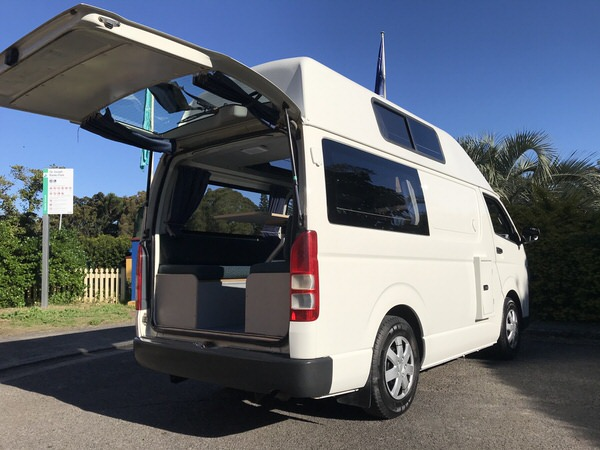 Rear view of Toyota Hiace Campervan with tailgate open