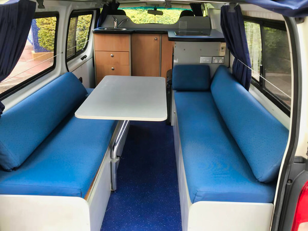 Toyota Hiace hitop campervans for sale - view of the lounge kitchen area