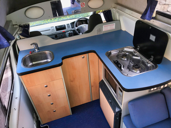 Kitchen area inside a Toyota Hiace Campervan for sale