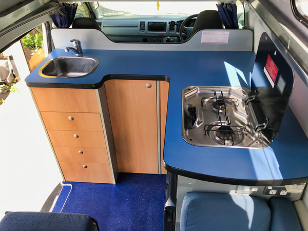 Toyota Hiace Ex-rental Campervan for sale - kitchen with sink, fridge and cooker