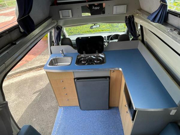 View of the kitchen inside Toyota Automatic Campervan for sale