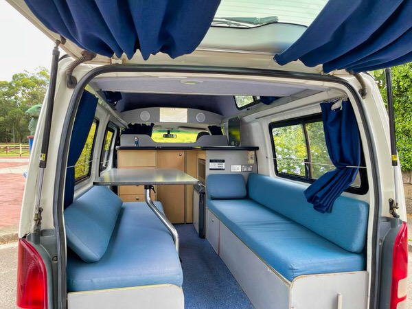 Toyota Hiace hitop campervan view of the open plan lounge area